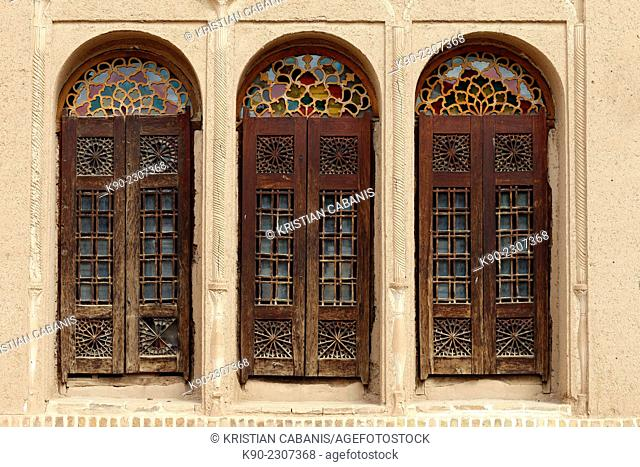 Traditonal wooden windows with colorful glas ornaments in the windows at Alexander's Prison, Yazd, Iran, Asia