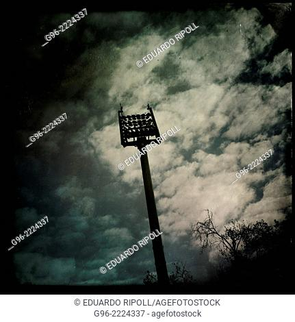 Stadium lighting tower, smart phone, shot