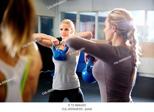 Women training with kettlebells in gym