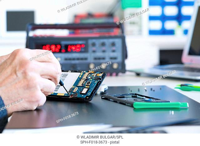 Person working on an electronic component