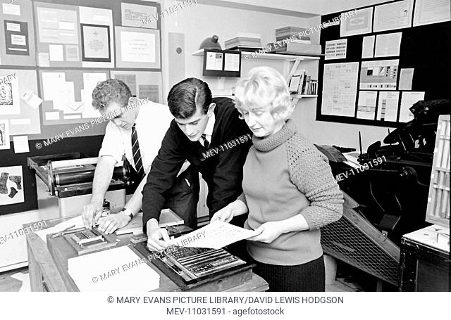 Two men and a woman using printmaking equipment at Atlantic College (United World College of the Atlantic), St Donat's Castle, Llantwit Major, Glamorgan