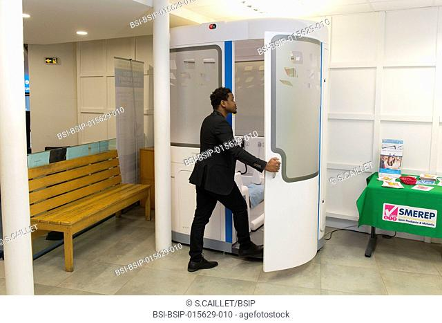 E-health monitoring booth made available for students with student health cover in Paris, France. Students can have a remote check-up, guided by adapted videos