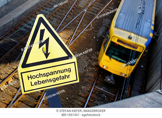 Sign, lettering Hochspannung Lebensgefahr, German for High voltage, danger of life, on a railway line of the suburban railway system