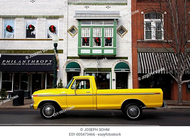 Historic Main Street with antique Yellow Pickup Truck in Franklin, Tennessee, a suburb south of Nashville, Williamson County, Tenn