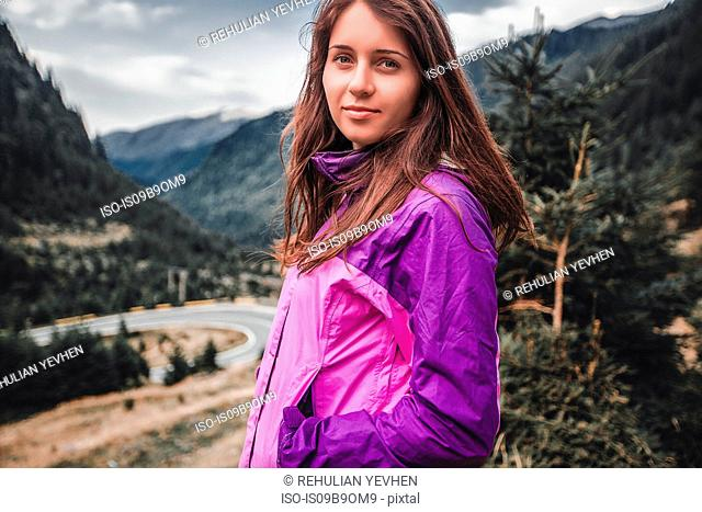 Portrait of young woman near mountain highway, Draja, Vaslui, Romania