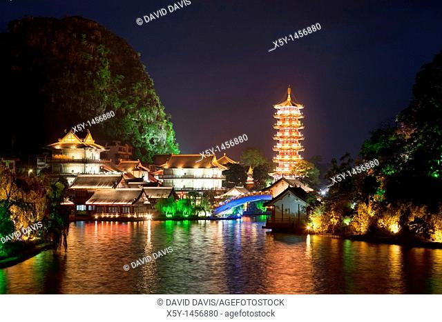 Mulong Pagoda also known as the Mulong Tower reflected in the Mulong Lake, Mulong Lake Park, Guilin, China