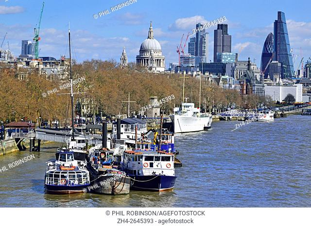London, England, UK. Boat moored in the River Thames with the City and St Paul's Cathedral in the background