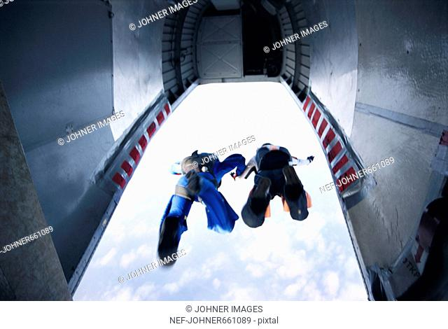 Two parachute jumpers leaving a plane, Sweden