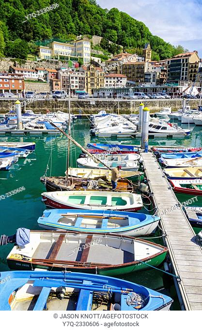 Boats in the small harbor below Monte Urgull next to the Old Town in San Sebastian, Gipuzkoa, Spain