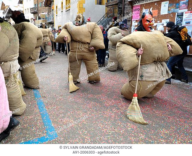 Switzerland, Valais, Herens valley, Evolene, Mardi Gras carnival, tradition of the disguised men with bags stuffed with 30 kgs of straw