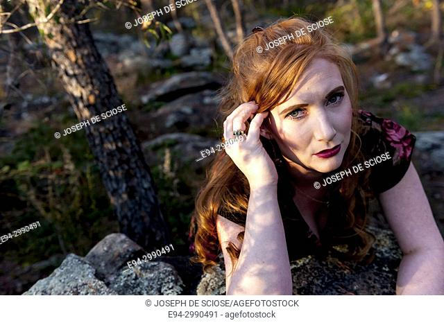 Portrait of a 27 year old redhead woman outdoors