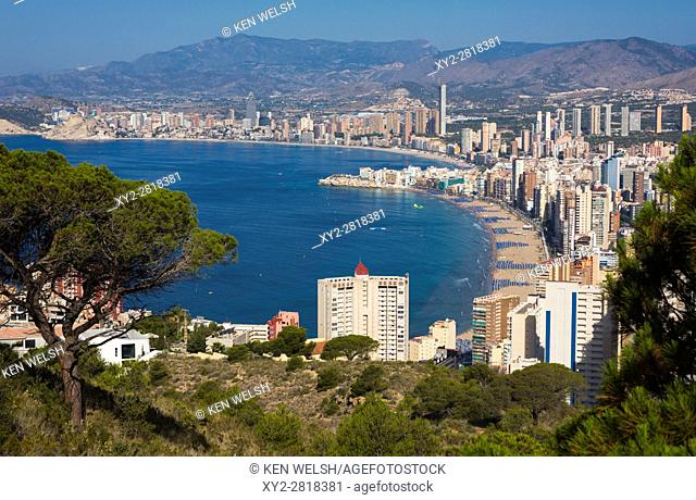 Benidorm, Costa Blanca, Alicante Province, Spain. Overall view showing Levante beach foreground and Poniente beach in background