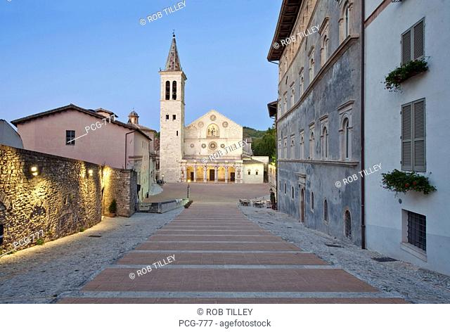 The landmark and historic Cathedral Duomo of Santa Maria Assunta, with tall clock tower. Historic religious place of worship