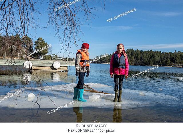 Girls standing at lake