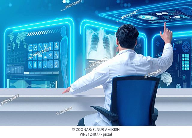 The male doctor in futuristic medical concept