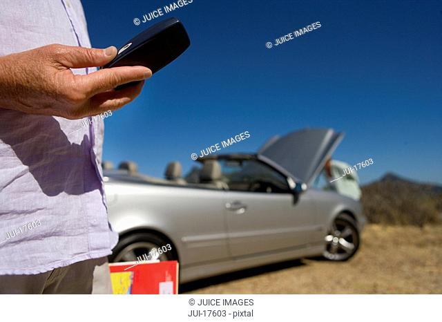 Man calling for roadside assistance