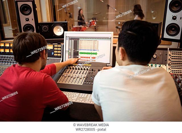 Audio engineers using sound mixer