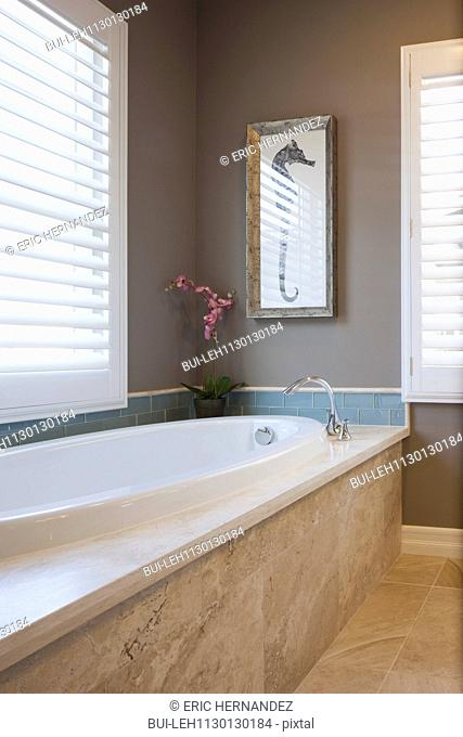 Bathtub in clean domestic bathroom