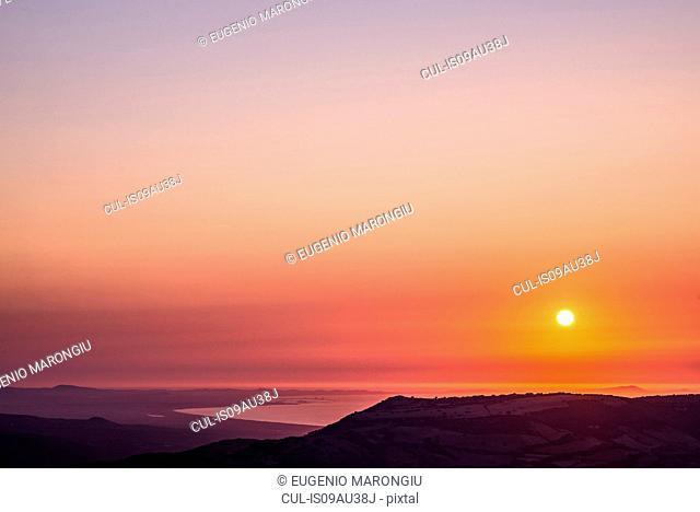 Orange sunset over ocean, Castelsardo, Sardinia, Italy
