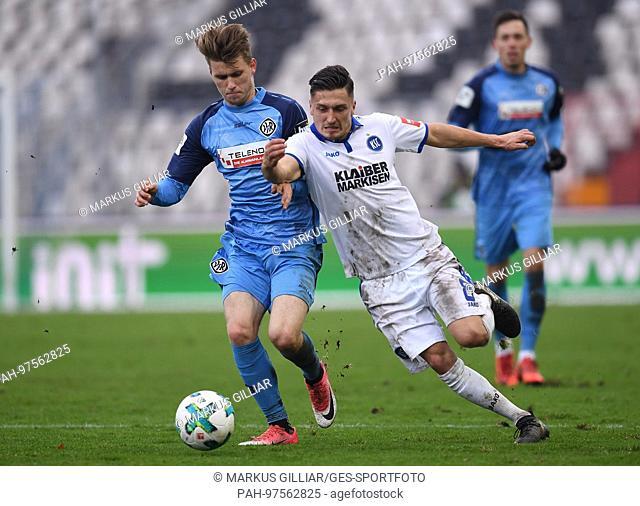 duels / Duell Marcel Mehlem (KSC) versus Lukas Laemmel (Aalen). GES/ Fussball/ 3. Liga: Karlsruher SC - VfR Aalen, 02.12