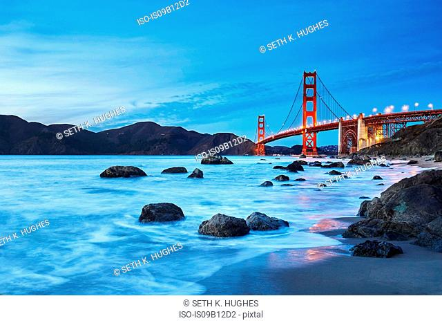 View of Golden Gate Bridge from Marshall's Beach at dusk, San Francisco, California, USA