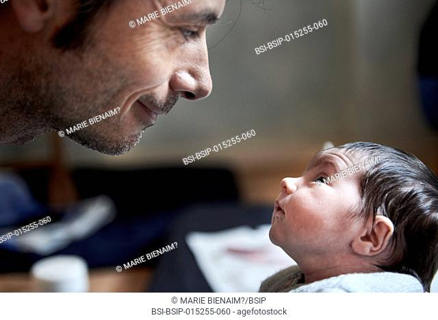 Reportage on a midwife in Lyon, France. Consultation with a 2-week old baby