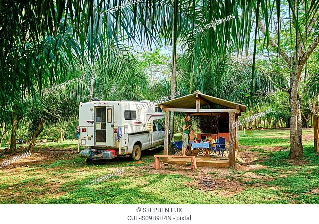Campervan parked on campsite by picnic shelter, Bonito, Mato Grosso do Sul, Brazil, South America