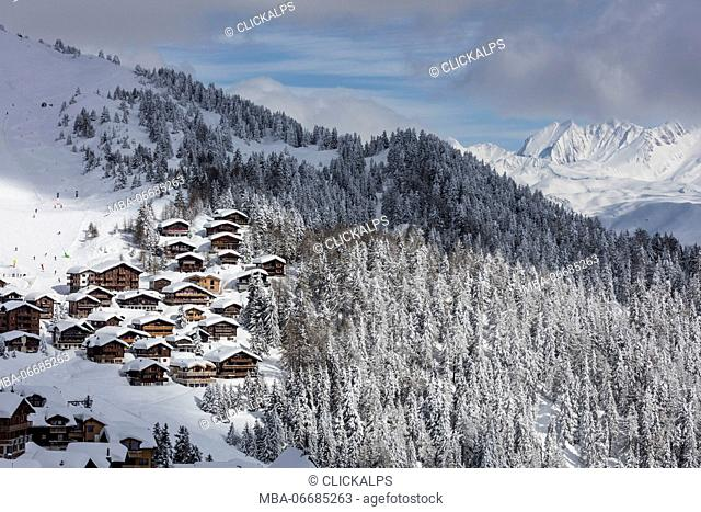 Snowy woods frame the typical alpine village and ski resort Bettmeralp district of Raron canton of Valais Switzerland Europe