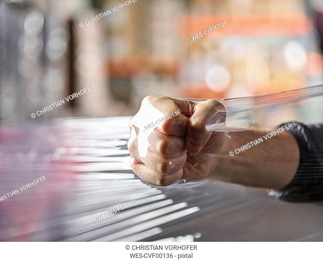 Fist inside plastic foil testing stability