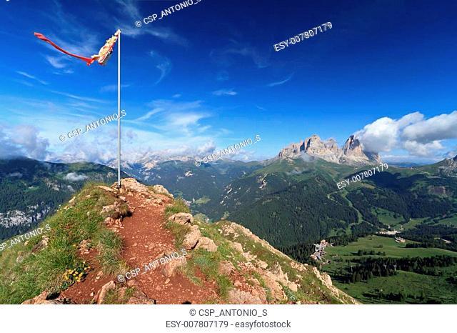 mountain peak with flag