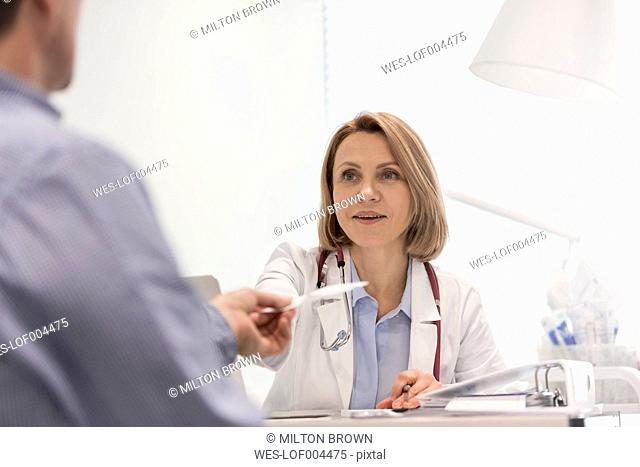 Doctor talking to patient in medical practice