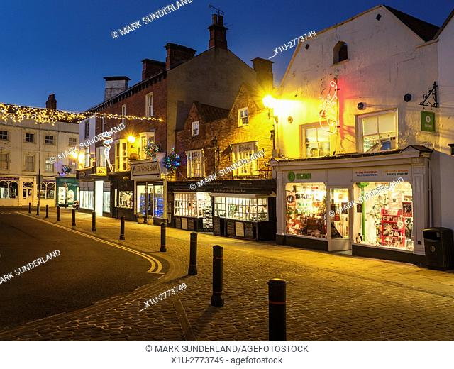 Market Place and Oldest Chemist Shop at Dusk at Christmas Knaresborough North Yorkshire England