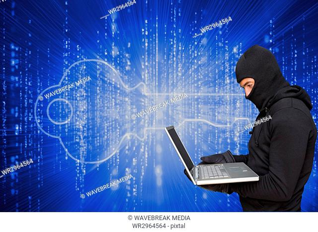 Cyber criminal wearing an hood is hacking a laptop against matrix code background