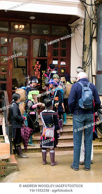 Black Hmong hilltribe women crowd outswide Sapa hotels hoping to sell trinkets and crafts Vietnam
