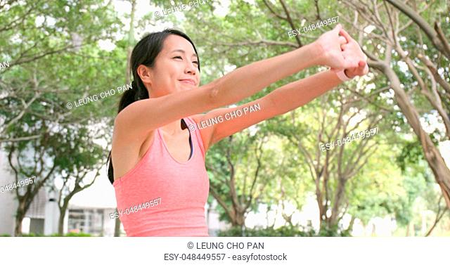 Sport Woman stretching hand at outdoor park