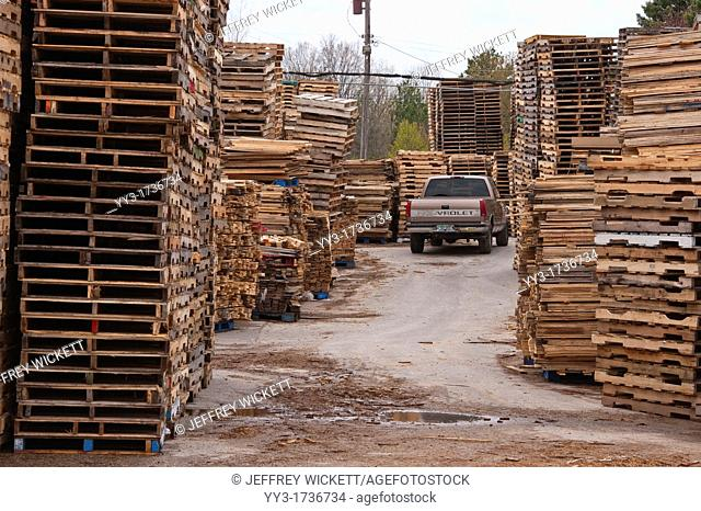 Pickup truck parked amid stacked pallets in Michigan, USA