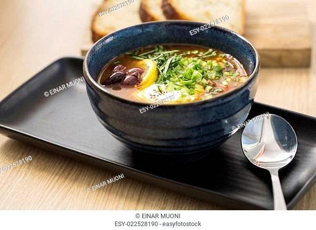 Bowl with delicious soup with beans