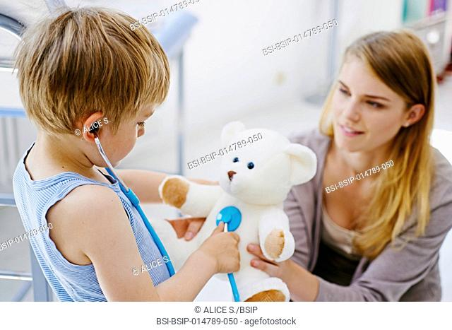Boy in consultation with his soft toy