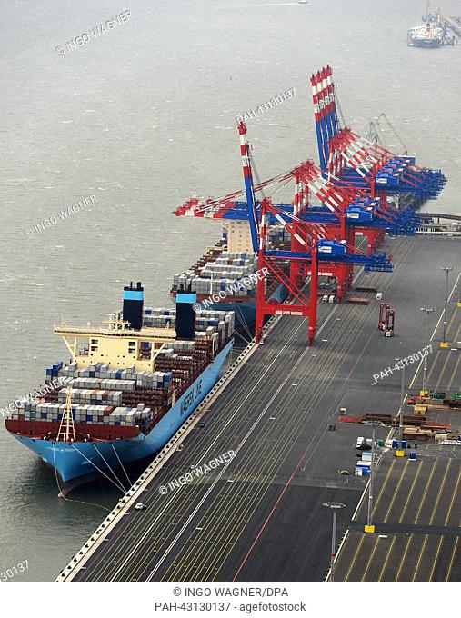 The 'Eugen Maersk' and the world's largest container ship 'Majestic Maersk' (B) is docked at the peer at JadeWeserPorts in Wilhemlshaven,Germany