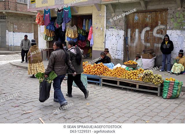 Fruit seller, street scene in Achacachi, Bolivia