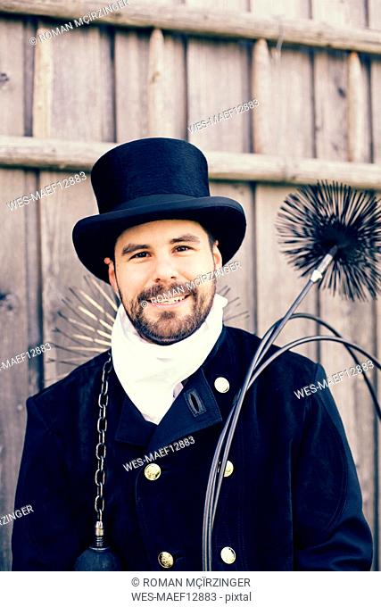 Portrait of smiling chimney sweep