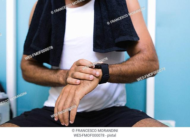 Close-up of athlete with smartwatch outdoors
