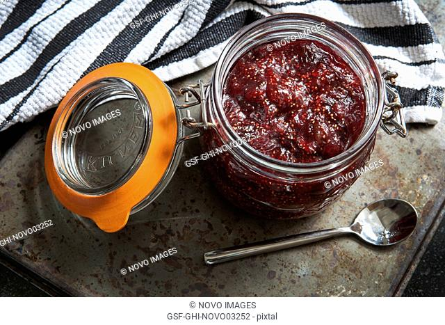 Fig Jam in Glass Jar with Spoon, High Angle View
