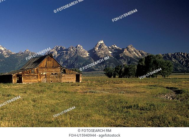 Grand Teton National Park, Jackson Hole, WY, Wyoming, Old wooden barn at Antelope Flats with a view of the Grand Teton Mountains in the background in Grand...