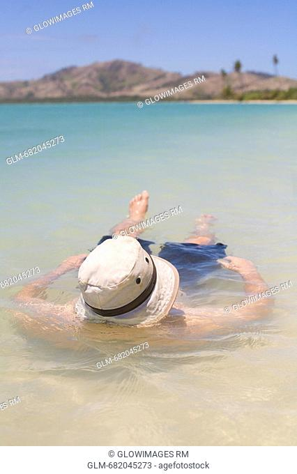 Close-up of a man floating on water