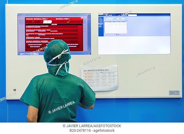 Surgeon looking at monitoring equipment in operating room, Ambulatory Surgery, Hospital Donostia, San Sebastian, Basque Country, Spain