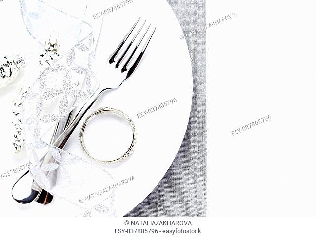 Festive table place setting with christmas decorations