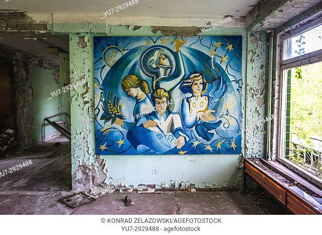 Soviet poster in High school No 2 in Pripyat ghost city of Chernobyl Nuclear Power Plant Zone of Alienation in Ukraine