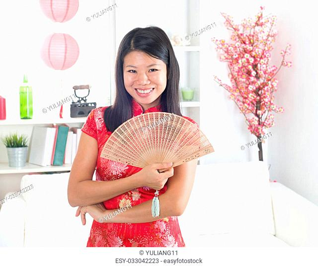 chinese new year girl lifestyle photo, with decorations on background