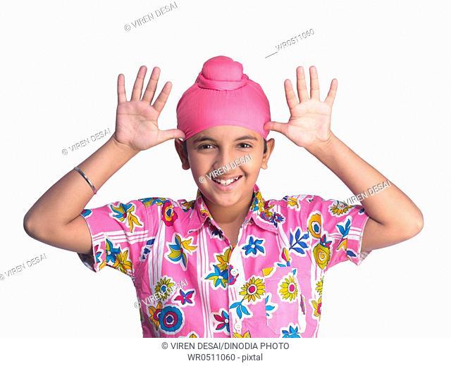 Portrait of Sikh boy teasing MR702Y